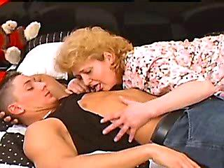 Old ugly slut masturbates on sofa